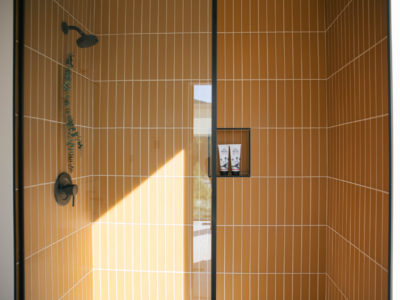 The Nooq: Falcon Glass Tile Bathroom