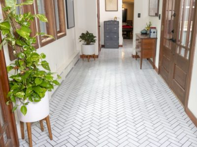 Zosia Mamet Cabin: Entryway with Handmade Tile Floor