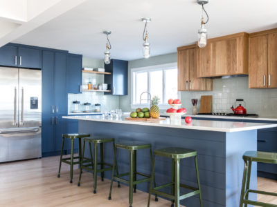 Blue Cabinets with Green Kitchen Tiles