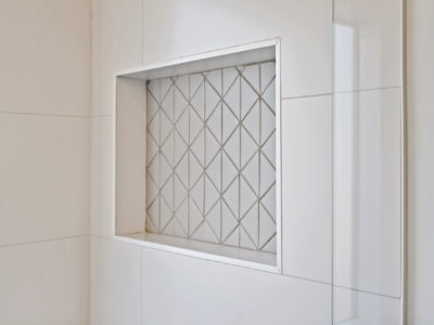 Triangle Shower Floor Tile with Niche Accent
