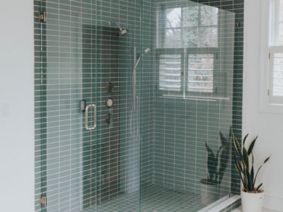 Blue-Green Shower Tile and Hexagon Floor Tile Bathroom