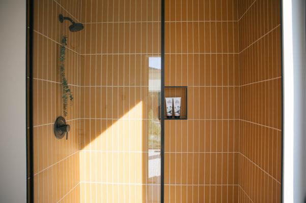 The Nooq: Falcon Glass Tile Bathroom