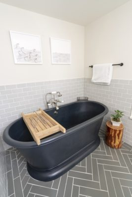 Zosia Mamet Cabin: Grey Subway Tile and Herringbone Bathroom