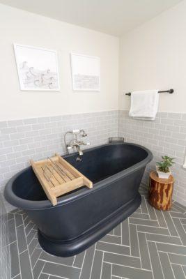 Zosia Mamet Cabin: Grey Subway Tile and Herringbone Bathroom