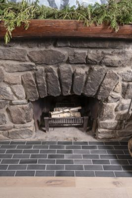 Zosia Mamet Cabin: Glazed Brick Fireplace Hearth