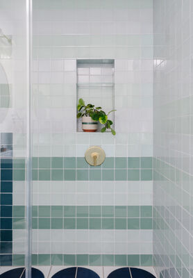Oh Joy!: Abstract Glass Guest Bathroom with Custom Fallow Floor